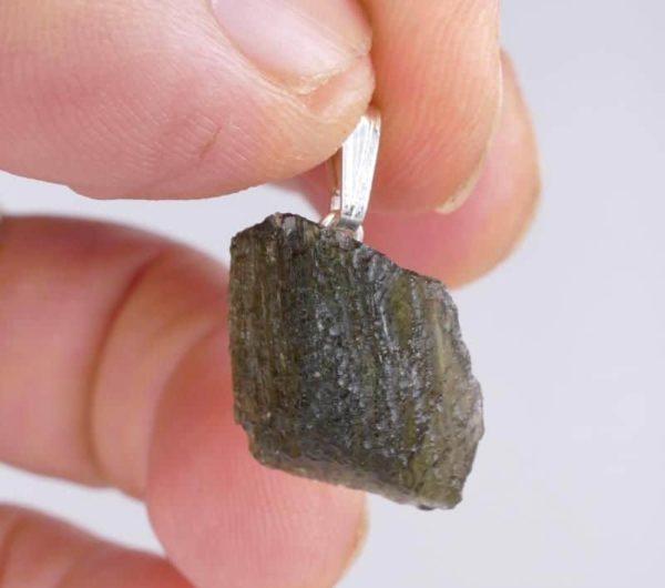 https://buymoldavite.com/product/genuine-raw-moldavite-drilled-in-sterling-silver-pendant-2-4grams/ 1