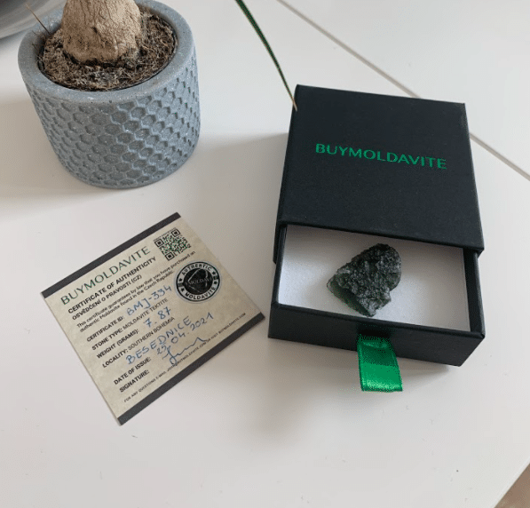 buymoldavite packaging and certificate of authenticity of the moldavite